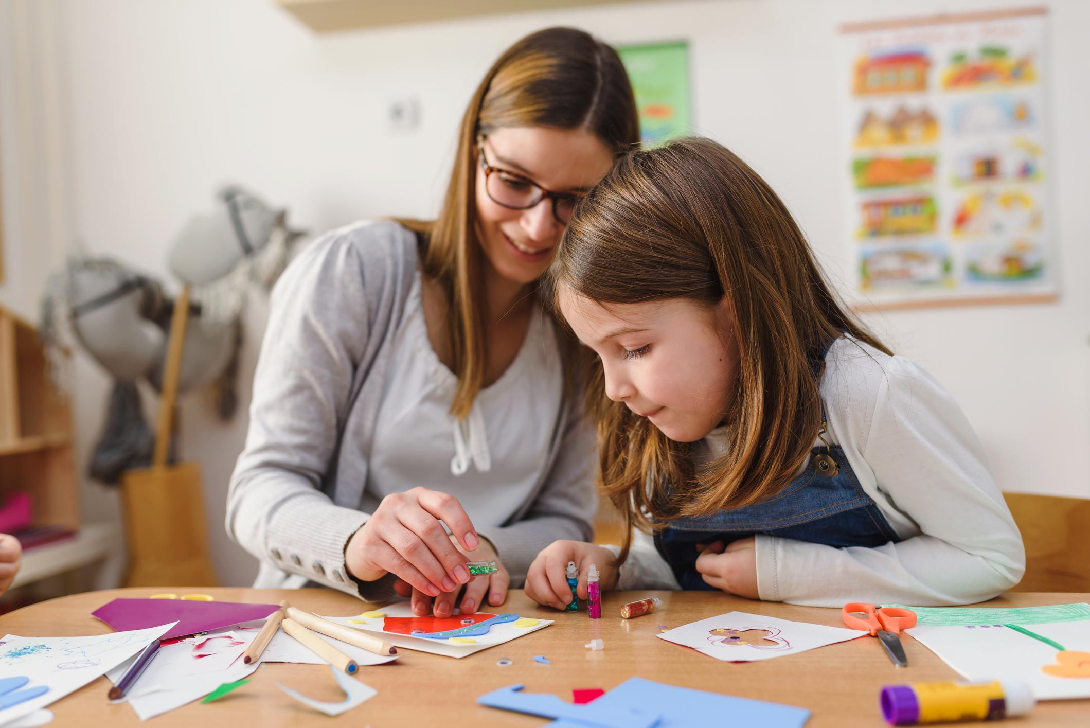 Preschool Teacher With Cute Girl – Creative Art Class